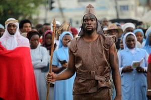 Good Friday traditions: Lagos, Nigeria: A man dresses as guard during a ritual procession