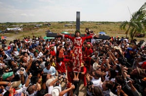 Good Friday traditions: San Pedro Cutud, Philippines: A man is hoisted on a cross by volunteers