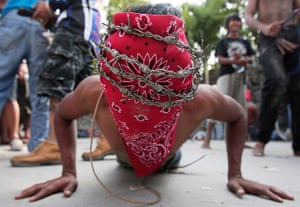 Good Friday traditions: Paombong, Philippines: A penitent wears a crown of barbed wire