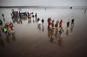 Good Friday traditions: Berwick-upon-Tweed, England: Pilgrims walk with crosses