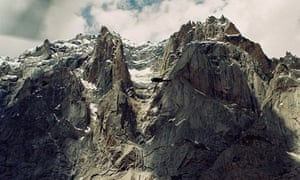 An army helicopter flies over Siachen Glacier in Kashmir where an avalanche has buried soldiers