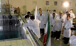 Iranian president, Mahmoud Ahmadinejad, tours a research reactor centre in Tehran