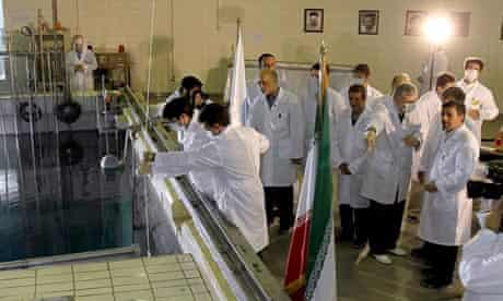 Iranian president, Mahmoud Ahmadinejad, tours a research reactor centre in Tehran