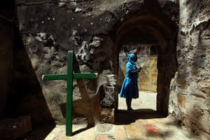 Easter Sunday: Ethiopian Orthodox Christian woman holds palm tree leaves