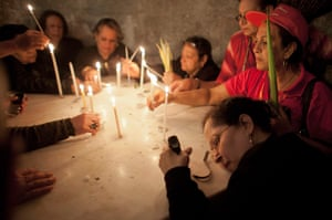 Easter Sunday: Orthodox Christian worshippers pray and light candles in Jerusalem
