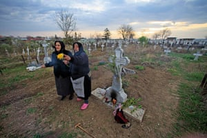 Easter Sunday: Women bring incense and flowers to the graves relatives on Palm Sunday