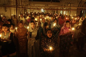 Easter Sunday: Pakistani Christians hold candles during an Easter vigil Mass