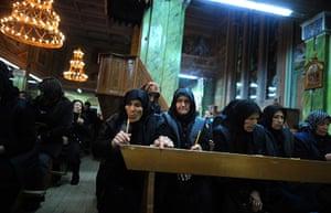 Easter Sunday: Bulgarian Catholic women attend an Easter vigil mass