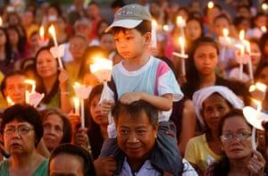 Easter Sunday: Catholics hold candlesat the dawn of Easter Sunday, Manila
