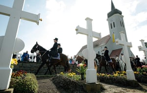 Easter Sunday: Men of the Sorbian community pass a cemetery on Easter Sunday