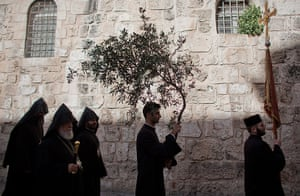 Easter Sunday: Orthodox Christian clergyman carries a branch of a olive tree Jerusalem