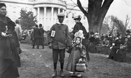 A boy holds the hand of a girl at the White House Easter Egg Roll in Washington in 1898