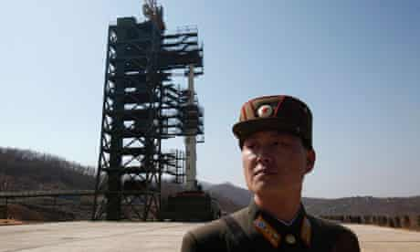 A North Korean soldier stands guard at the launch site for the Unha-3 long-range rocket.