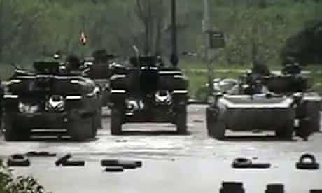 An image grab taken from video uploaded on YouTube purportedly shows Syrian tanks stationed in Homs
