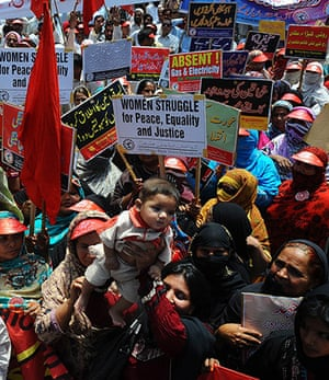 May Day 2012: Pakistani labour union workers carry placards at a May Day rally in Lahore