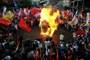 May Day 2012: Manila: Burning the effigy of Philippine President Benigno Aquino