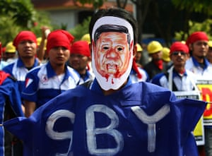 May Day 2012: Jakarta, Indonesia: A worker wears a mask of the Indonesian President