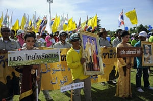 May Day 2012: Narathiwat, Thailand: Thai labourers wave national flags and hold portraits