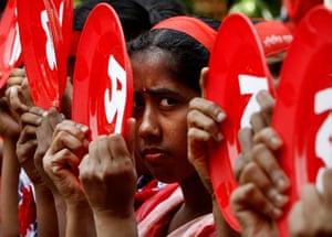 May Day 2012: Dhaka, Bangladesh: A Bangladeshi garment worker participates in a rally