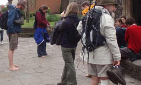 Pilgrims removing shoes
