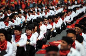 May Day rallies 2012: Istanbul: Protestors sit with red flags during a May Day rally