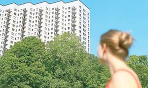 Woman looking at an apartment building