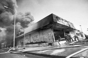 Rodney King riots: A Trak Auto shop burns on Washington Blvd, LA, April 1992