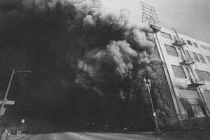 Rodney King riots: A burning building at Union and 7th Street, 1992