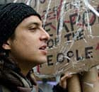 Jason Ahmadi of New York takes part in May Day protests