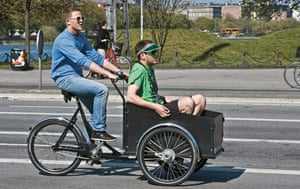 Big Picture, bikes: Big Picture: A male cycling with another male in a cart