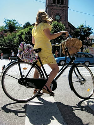 Big Picture, bikes: Big Picture: Woman wearing a yellow dress on a bike