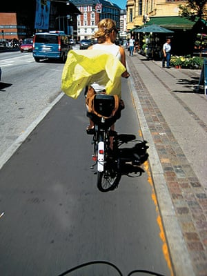 Big Picture, bikes: Big Picture: girl on a bike with her dress blowing in the wind