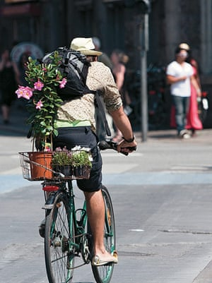 Big Picture, bikes: Big Picture: man with a plant on the back of his bike