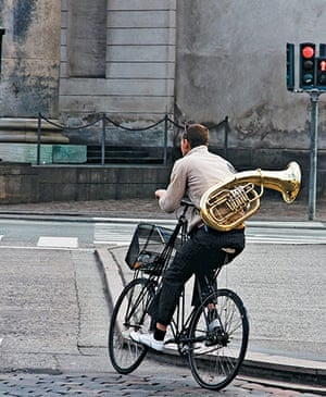 Big Picture, bikes: Big Picture: Man with a trumpet on a bike