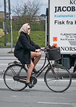 Big Picture, bikes: Big Picture:. woman wearing a headscarf on abike