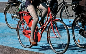 Big Picture, bikes: Big Picture: woman on a red bike