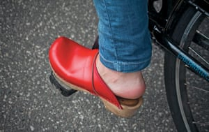Big Picture, bikes: Big Picture: close of woman weather a red clog on a pedal