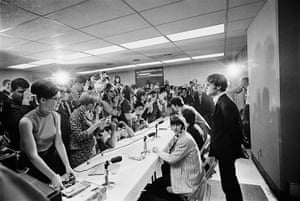 Harry Benson: John stands to answer a question at the press conference, Memphis 1966
