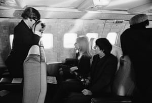 Harry Benson: John photographs George and Cynthia on board a flight, 1964