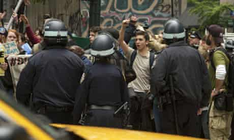 Occupy Wall Street supporters are corralled by police officers in New York on May Day.