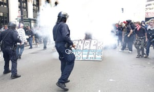 Police officers fire tear gas to control a group of Occupy protesters in downtown Oakland.