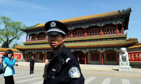 Chinese police guard entral headquarters for the Communist Party of China