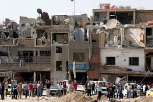 Damascus Bombs: People walk near damaged buildings
