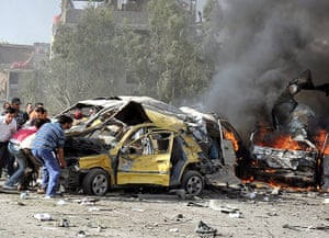 Damascus Bombs: People try to remove debris as cars burn