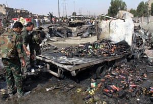 Damascus Bombs: Syrian soldiers check a burned truck