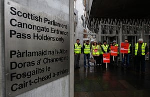 Public Sector strikes: PCS union members hold placards during a national day of strike action