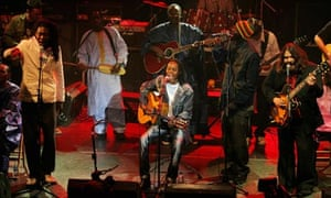 Baaba Maal performs at the Africa Express show in 2008 with other African and western musicians.