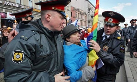 Russian police detain a gay rights activist during a protest in St Petersburg