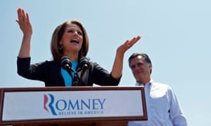 Michelle Bachman speaks next to Mitt Romney during a rally at Crofton Industries in Portsmouth