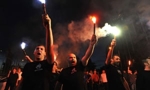 Supporters of the extreme right party Golden Dawn hold flares during election results